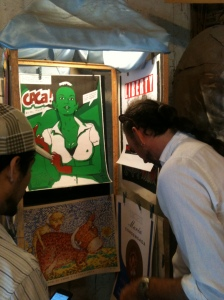 Dan Smith and Claudio Sotolongo find a poster by Darwin Fornés in a shop in La Habana.